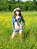Devon rockin' the country look outside in a gorgeous field and making it look hot!
